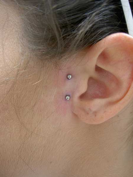 Fotos de Piercing Surface